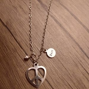 Claire's peace sign heart necklace